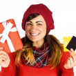 Smiling brunette holding gift and cards — Stock Photo #60839943