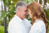 Casual couple smiling at each other — Stock Photo
