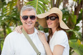 Holidaying couple smiling at camera — Stock Photo