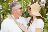 Holidaying couple smiling at each other — Stock Photo