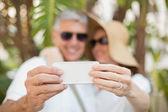 Holidaying couple taking a selfie — Stock Photo