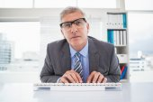 Focused businessman typing at his desk — Stock Photo