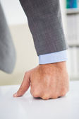 Businessmans fist clenched over desk — Stock Photo