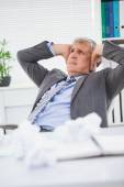 Stressed businessman covering his ears — Stockfoto
