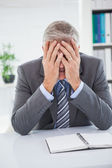 Stressed businessman covering his face — Stock Photo