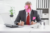 Overwhelmed businessman with sticky notes on head — ストック写真
