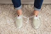 Casual mans shoelaces tied together  — Stock Photo