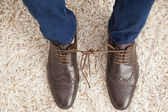 Classy mans shoelaces tied together  — Stock Photo