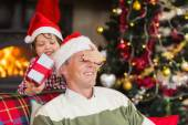 Son surprising his father with christmas gift — Foto Stock