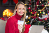 Blonde shopping online with laptop at christmas — Stock Photo