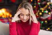 Blonde getting a headache on christmas day — Stock Photo