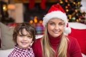 Festive mother and son smiling at camera — Stock Photo