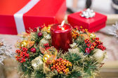 Candle and wreath on table for christmas — Stock Photo