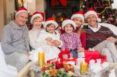 Happy extended family looking at camera at christmas time — Stock Photo
