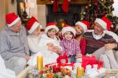 Multi generation family sitting on a couch during christmas — Stock Photo