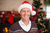 Portrait of a smiling handsome man in santa hat — Stock Photo