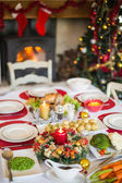 Christmas dinner table with food — Stock Photo