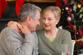 Loving mature couple with arm around — Stockfoto