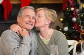 Mature woman kissing the cheek of her husband — Stock fotografie