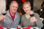Couple toasting to the camera with red wine — Stock Photo