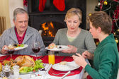 Smiling extended family at the christmas dinner table — Stock Photo