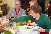 Extended family at the christmas dinner table — Stock Photo