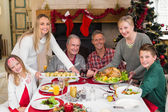 Two women serving christmas dinner to their family — Stock Photo