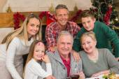 Happy extended family posing at christmas time — Stock Photo