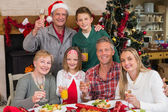 Family toasting with white wine in a christmas dinner — Stock Photo