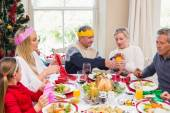 Family in party hat having fun at christmas time — Stok fotoğraf