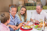 Mother, father and grandfather listening the little boy — Stock Photo