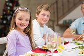 Portrait of smiling little girl at christmas dinner — Stock Photo
