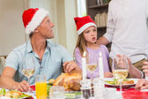 Father and daughter in santa hat at christmas time — Stok fotoğraf