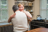 Senior couple hugging and smiling — Stock Photo