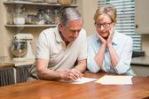 Senior couple working out their bills — Stock Photo