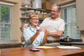 Senior couple working out their bills — Stock Photo