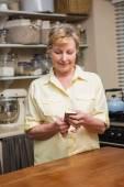 Senior woman sending a text message — Stock Photo