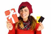 Smiling brunette holding gift and cards — Stock Photo
