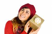 Brunette in hat listening a gift — Stok fotoğraf