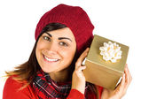 Pretty brunette in hat holding a gift  — Stock fotografie