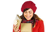 Happy brunette opening christmas gift  — Fotografia Stock