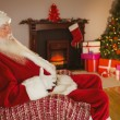 Santa claus sitting and holding his belly  — Stock Photo #60840685