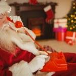 Santa claus making a phone call — Stock Photo #60840715