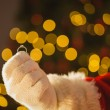 Hand of father christmas holding engagement ring — Stock Photo #60842121