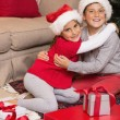 Brother and sister hugging near gifts  — Stock Photo #60843073