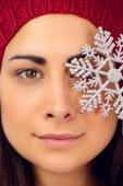 Close up of a brunette holding snowflake — Stock Photo