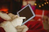 Santa claus touching tablet pc — Foto de Stock