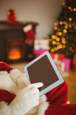 Father christmas touching tablet pc — 图库照片