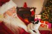 Santa claus holding engagement ring with his box — Foto Stock