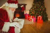 Santa claus reading his list  — Foto de Stock